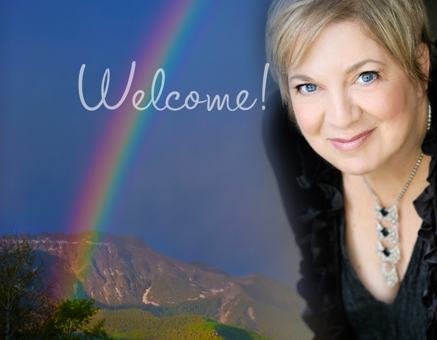 photo of adorable woman with pixie haircut superimposed over rainbow sky